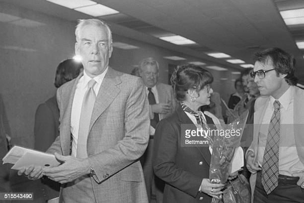 Michelle Triola Marvin holding a single rose is ignored by her former lover Lee Marvin as they return to Superior Court after a lunch break The judge...