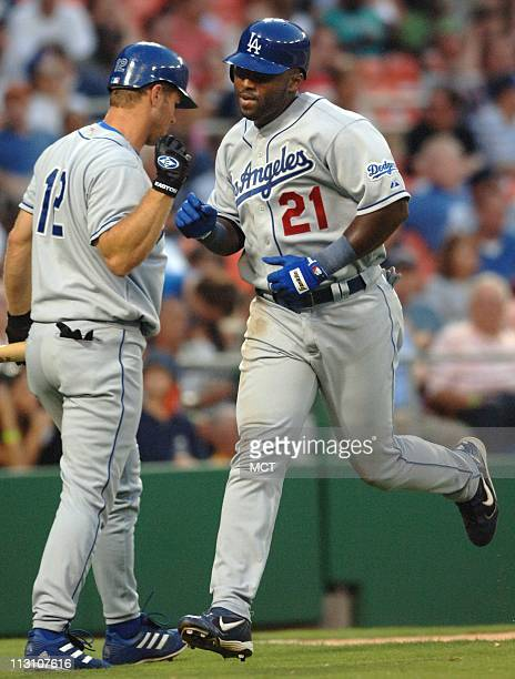 WASHINGTON DC Los Angeles' Milton Bradley is congratulated by teammate Jeff Kent after Bradley hit a home run in the third inning of the Dodgers game...