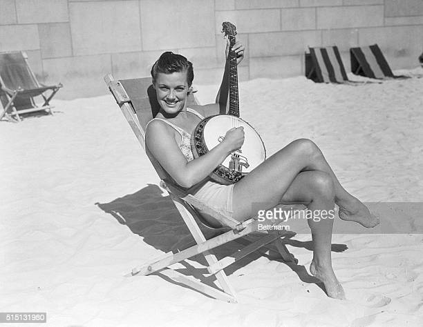 Musical Mermaid After equaling her world backstroke record of 1112 for the 100 yards pretty Eleanor Holm celebrates by plinking a few chords at the...