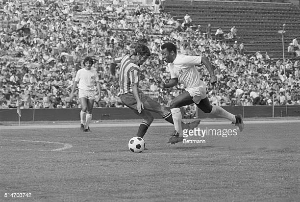 Los Angeles: Pele of Brazil's Santos soccer team, dribbles the ball down the field of the Coliseum, as Guadalajara, Mexico defensive player Gustavo...