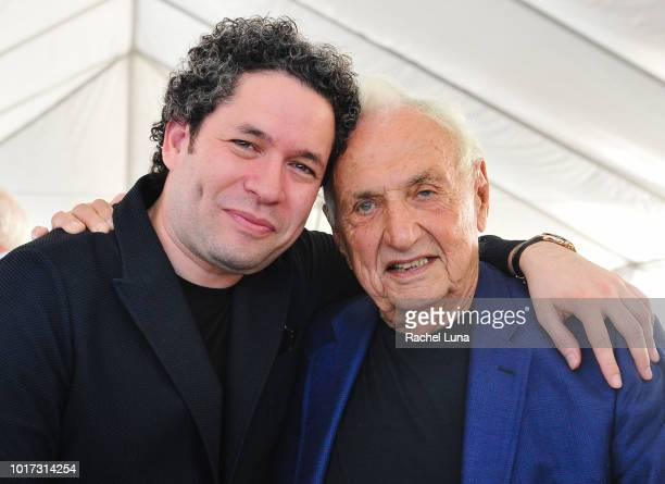 Los Angeles Philharmonic Music Artistic Director Gustavo Dudamel and architect Frank Gehry pose for a photo at the design unveiling of the Judith and...