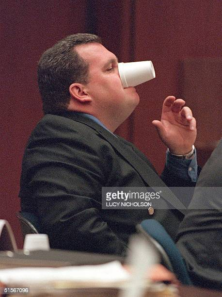 Los Angeles Plice Department Rampart division Sgt Brian Liddy plays with an empty cup during his appearance to court for the police corruption trial...