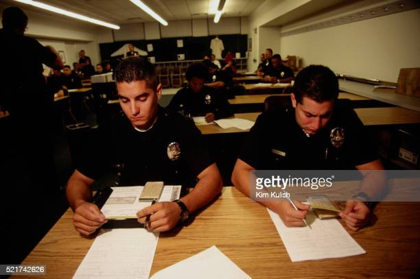 los angeles police at the newton precinct - los angeles police department stock pictures, royalty-free photos & images