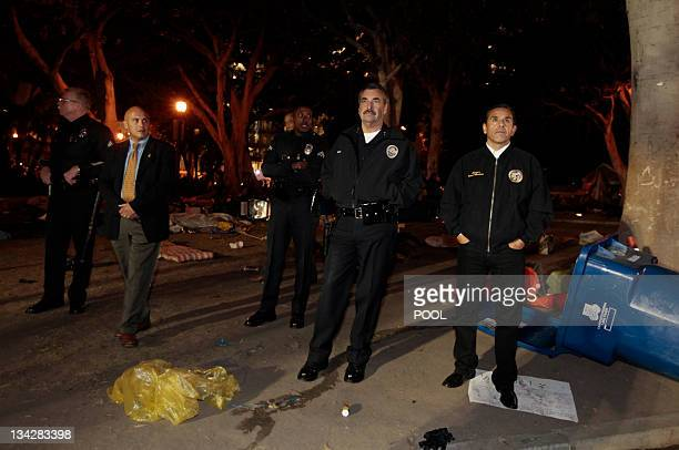 Los Angeles Police Chief Charlie Beck and Los Angeles Mayor Antonio Villaraigosa look over the damage after authorities dismantled the Occupy LA...