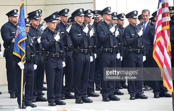 Los Angeles police chief Charlie Beck and mayor Eric Garcetti inspect the new Police recruits on July 8 2016 in Los Angeles California where Snoop...
