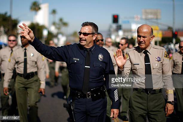 Los Angeles Police Chief Charlie Beck and retiring Los Angeles County Sheriff Lee Baca march in the 29th annual Kingdom Day Parade on January 20,...