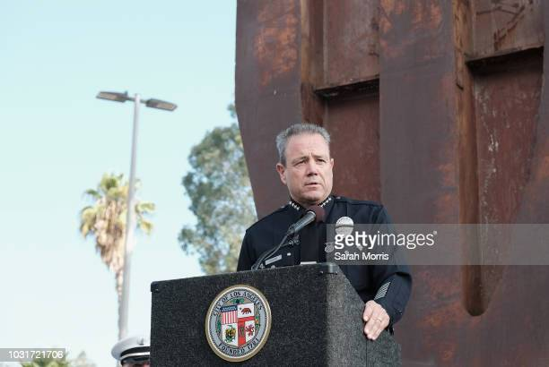 Los Angeles Police Chief Michael Moore speaks in front of a piece of the World Trade Center during a September 11 memorial at the Los Angeles Fire...