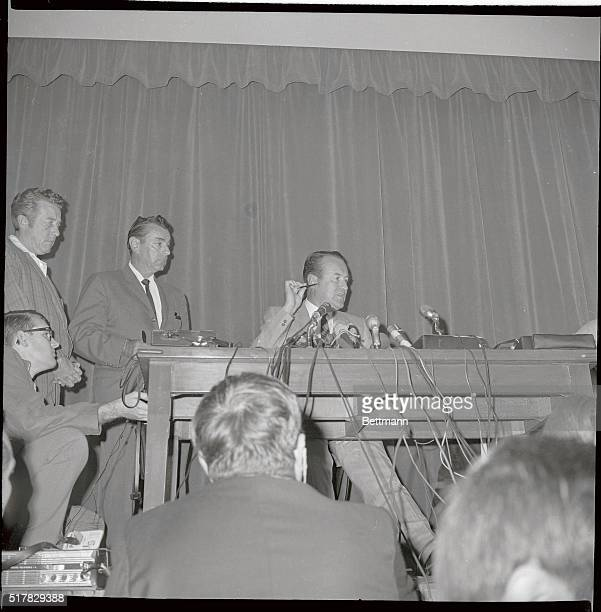 Los Angeles Police Chief Thomas Reddin is shown at a press conference as he illustrates point of impact of 22 caliber bullet which struck Senator...