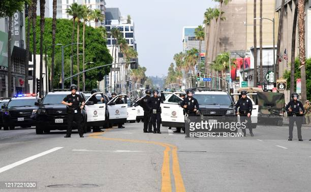 Los Angeles police close off the road to cars on Sunset Boulevard in Hollywood, during a demonstration over the death of George Floyd while in...