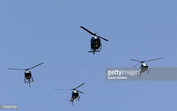 Los Angeles Police Department Air Support Division helicopters fly the Missing Man Formation over the LAPD ceremony to pay tribute to the 194 Los...