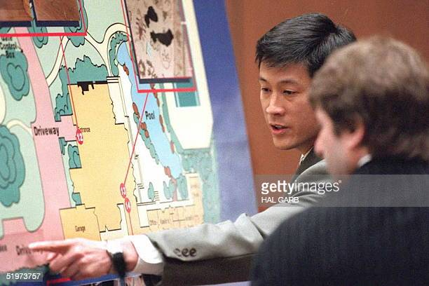 Los Angeles Police Department evidence technician Dennis Fung points, 05 April, to a drawing of the driveway at O.J. Simpson's house where blood...