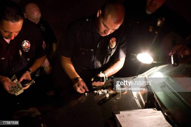Los Angeles Police Department gang unit officers found a hidden interior compartment with money and narcotics belonging to the driver after stopping...