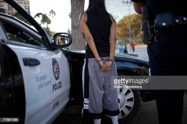 Los Angeles Police Department gang unit officers question a confirmed MS13 street gang member in Lafayette Park September 13 2007 in the Rampart area...