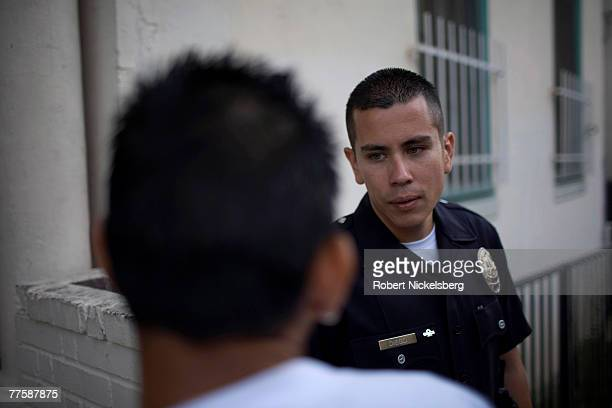Los Angeles Police Department gang unit officers question a confirmed MS-13 street gang member September 14, 2007 in the Rampart area of Los Angeles,...
