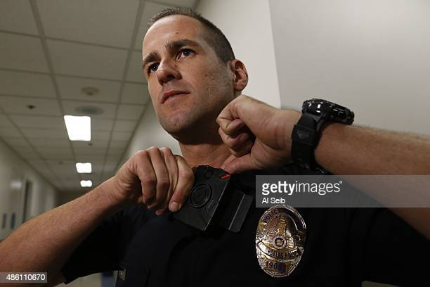 Los Angeles Police Department Officer Jim Stover demonstrates the use of a body camera during a training session at Mission Station on August 31 2015...