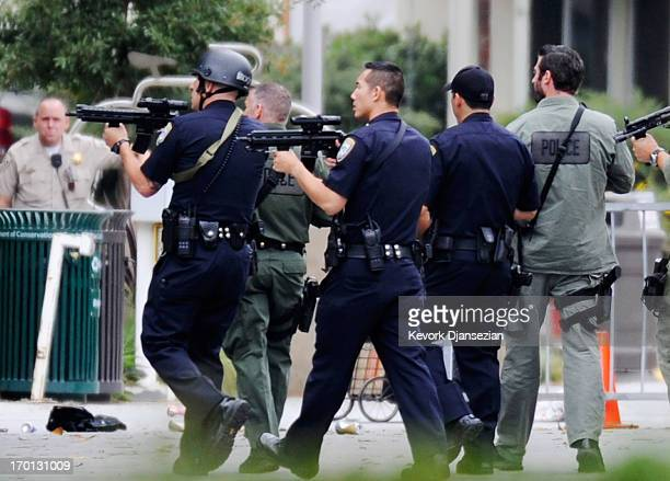 Los Angeles Police Department officers along with Los Angeles County SWAT team members search the grounds of Santa Monica College near the library...