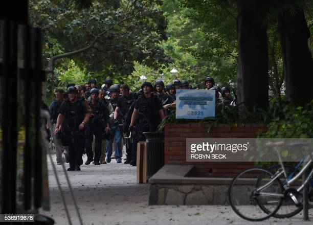 Los Angeles Police Department officers and other security search the area on June 1 2016 at the University of California's Los Angeles campus on June...