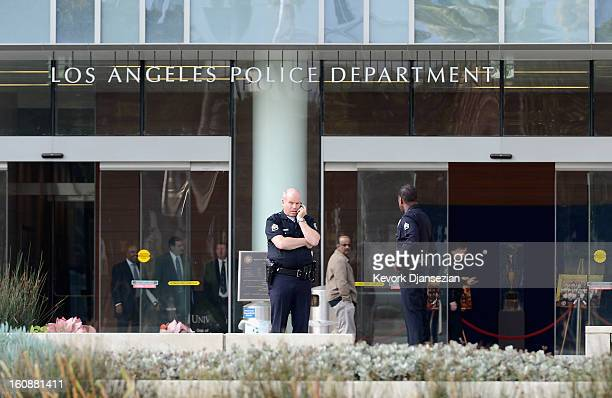 Los Angeles Police Department officers are deployed around the police headquarters on February 7 2013 in Los Angeles California A former Los Angeles...