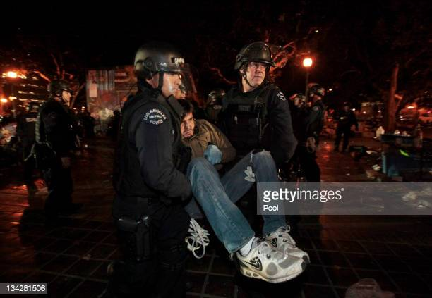 Los Angeles Police Department officers arrest a protester during the eviction of the Occupy LA tent encampment outside City Hall in the early hours...
