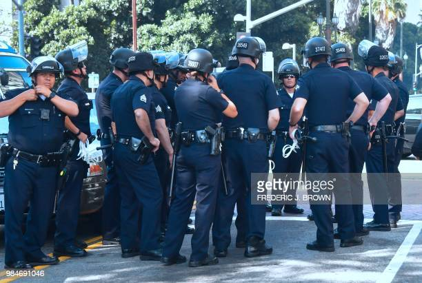 Los Angeles Police Department officers arrive on the scene to arrest members of the clergy from different denominations in an act of civil...