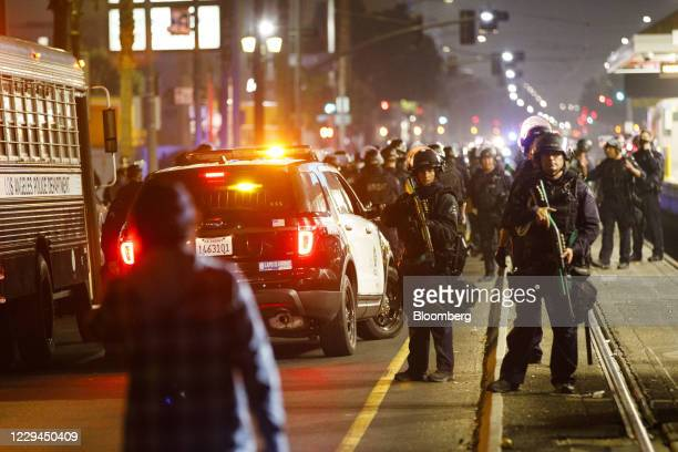 Los Angeles Police Department officers clear demonstrators from train tracks after declaring an unlawful assembly on election night in Los Angeles,...