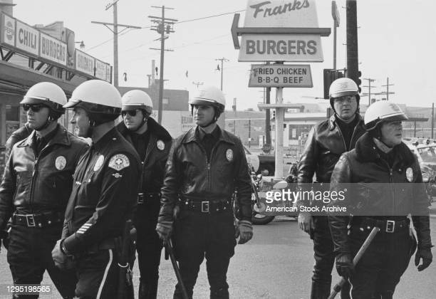 Los Angeles Police Department officers during a shoot-out with the Black Panthers outside a diner in Los Angeles, California, USA, circa 1970. The...