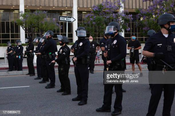 Los Angeles Police Department officers form a police line in riot gear after a Black Lives Matter Protest in solidarity with other national...