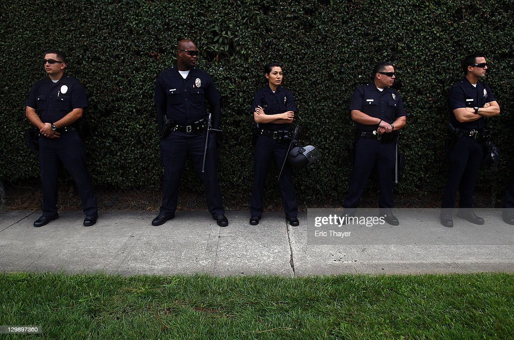 Los Angeles Police Department officers keep watch as protesters demonstrate the annual shareholder meeting of News Corp at Fox Studios October 21, 2011 in Century City, California. Protesters are demonstrating against Fox and News Corp's for what they see as one-sided reporting practices.