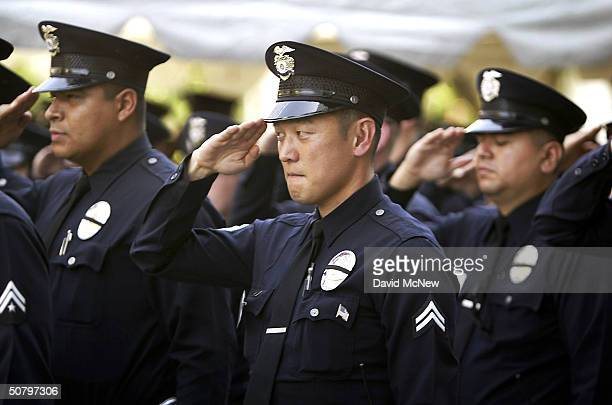 Los Angeles Police Department officers salute during the LAPD ceremony to pay tribute to the 194 Los Angeles officers who have fallen since 1907...