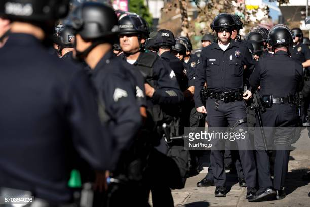 Los Angeles Police Department officers stand by during a protest against the Trump Administration in Los Angeles, California on November 4, 2017....
