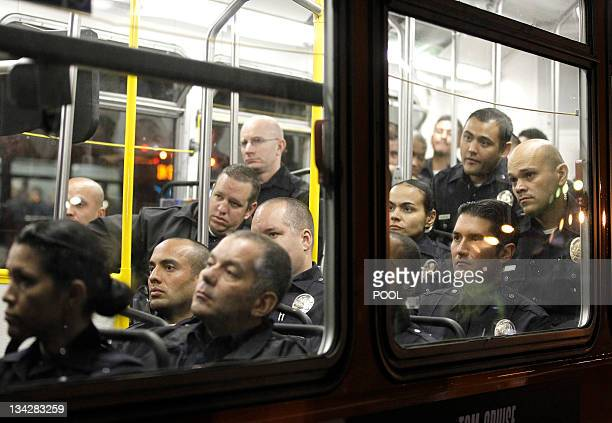 Los Angeles Police Department officers wait on a bus before they evict protesters from the Occupy LA encampment outside City Hall in Los Angeles...