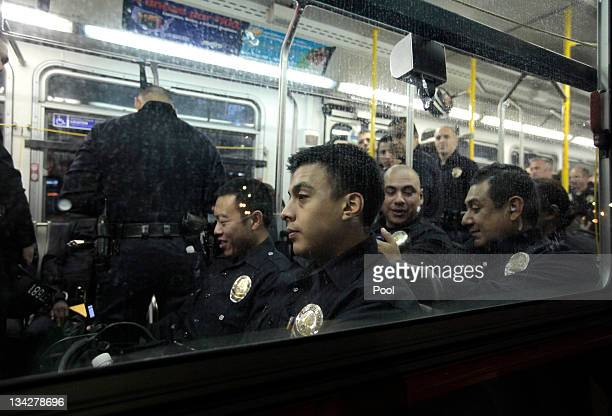 Los Angeles Police Department officers wait on a bus to transport them to the Occupy LA encampment outside Los Angeles City Hall to evict protesters...