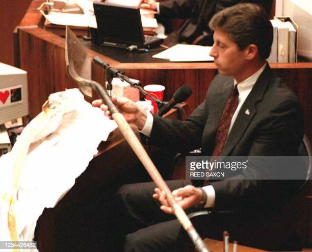 Los Angeles Police detective Mark Fuhrman holds up the shovel found in O.J. Simpson's Ford Bronco during the investigation into the murders of Ron...
