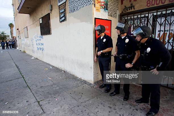 Los Angeles Police observe suspected gang members who fired guns in the air at the funeral services for Stanley 'Tookie' Williams at Bethel AME...