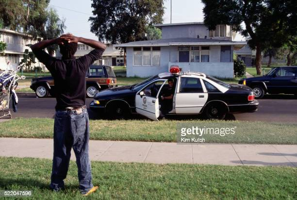los angeles police officer detaining a suspect - los angeles police department stock pictures, royalty-free photos & images