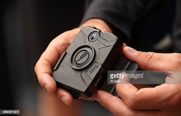 Los Angeles Police Officer Jim Stover, with Information Technology Bureau demonstrates use of the new LAPD body camera during a press conference at...