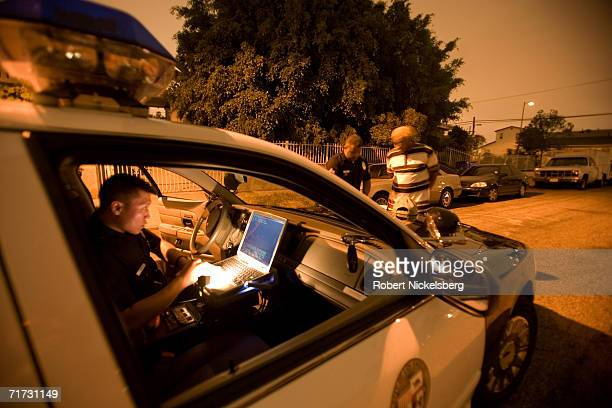 A Los Angeles police officer question a suspected drug dealer after finding a small quantity of speed and a smoking pipe in his van on August 3 2006...