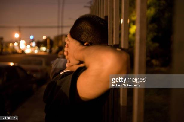 A Los Angeles police officer questions one of four hispanic minors caught tagging or spray painting a wall with gang graffiti on August 3 2006 in the...
