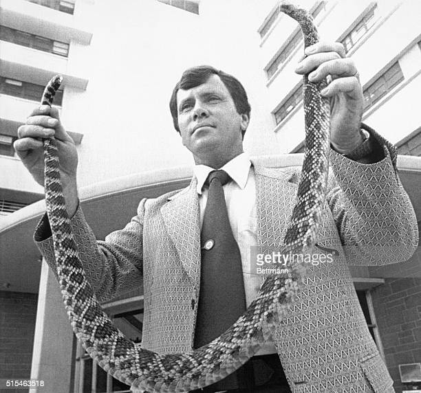 Los Angeles police officer Richard Grotsley holds rattlesnake that bit attorney Paul Morantz as he was reaching into his mailbox Authorities are...