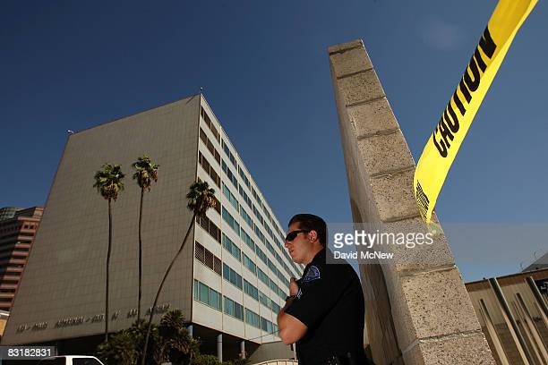 Los Angeles police officer stands guard outside Parker Center headquarters for the Los Angeles Police Department as a suspicious package is removed...