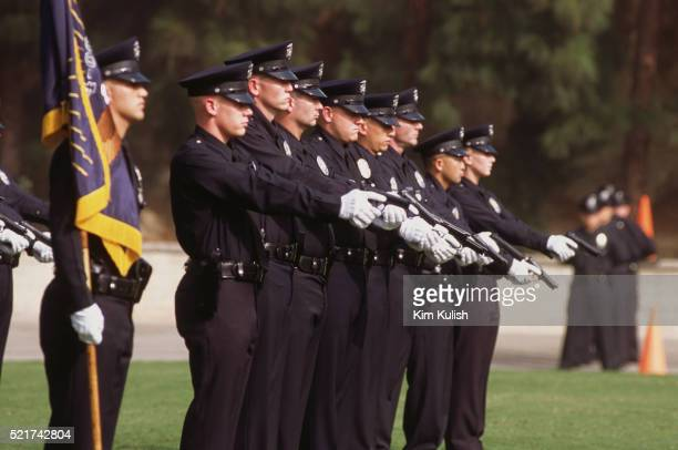 los angeles police officers at graduation ceremony - los angeles police department stock pictures, royalty-free photos & images