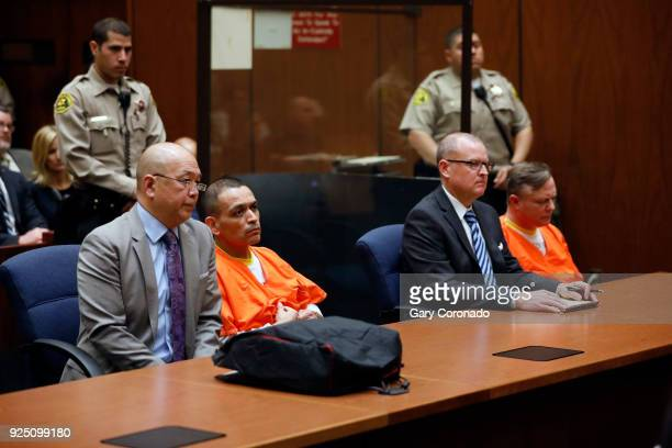 Los Angeles Police officers Luis Valenzuela seated second from left and James C Nichols far right shown with defense attorneys Bill Seki left and...
