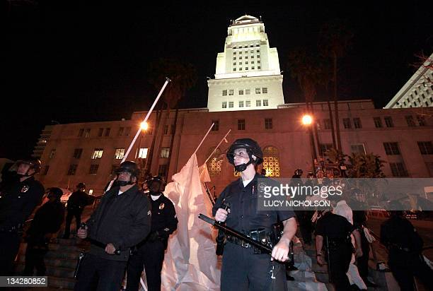 Los Angeles police officers stand guard as they evict protesters from the Occupy Los Angeles encampment outside City Hall on November 30 2011 Riot...