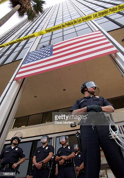 Los Angeles police officers stand guard in front of the Cable News Network building as protesters demonstrate against CNN's coverage of the USled war...