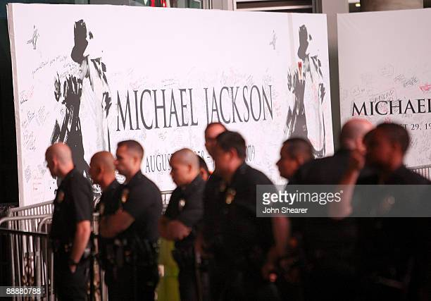 Los Angeles Police Officers stand guard outside at the Michael Jackson public memorial service held at Staples Center on July 7, 2009 in Los Angeles,...