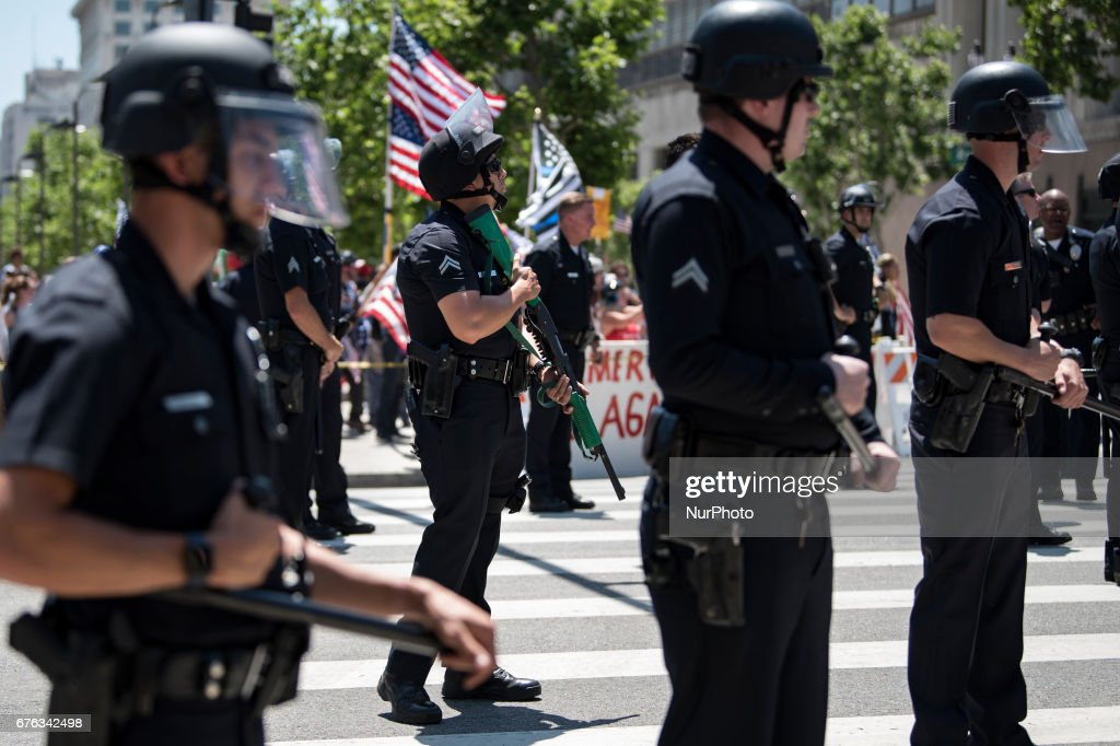 Los Angeles police officers standing between Trump supporters and the May Day protestors in Los Angeles, California on May 1, 2017. Activists marked the International Workers' Day with rallies in support of rights for workers and immigrants, as well as opposition to Presidents Donald Trump.
