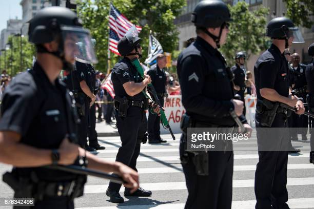 Los Angeles police officers standing between Trump supporters and the May Day protestors in Los Angeles, California on May 1, 2017. Activists marked...