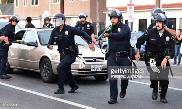 Los Angeles police officers target a protester for violating curfew in Hollywood California on June 2 2020 Antiracism protests have put several US...