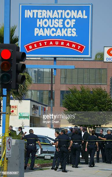 Los Angeles Police oficers at the scene where undercover officers shot and killed a robery suspect in the parking lot of an IHOP at the corner of...