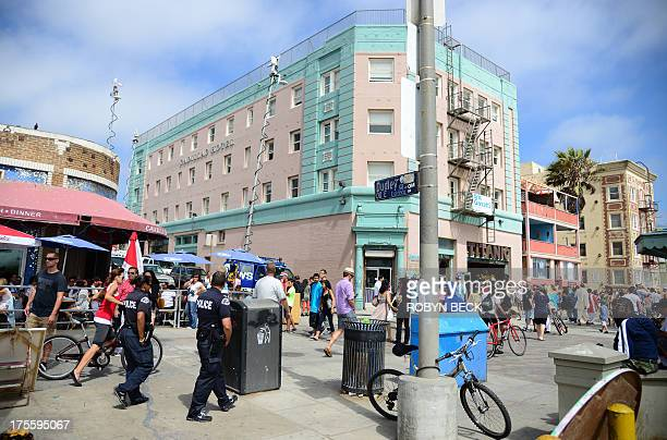 Los Angeles police patrol on the Venice Beach boardwalk on August 4 2013 One day earlier 32yearold Italian newlywed Alice Gruppioni was killed after...